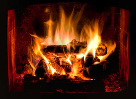wood burning: HDR photo of hot and cosy fireplace Stock Photo