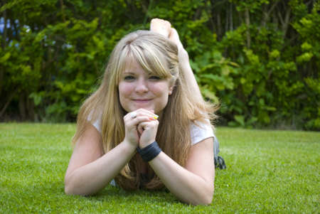 Girl smiling and looking happy on a lawn Stock Photo - 7591353