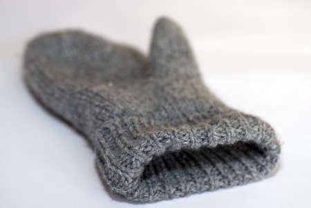 Warm mitten made of wool on a white background, close-up with very shallow depth of field Stock Photo - 8695671