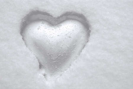Romantic white heart embedded in snow crust Stock Photo - 8695677