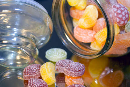 Close up of Colorful caramels in glass pot photo