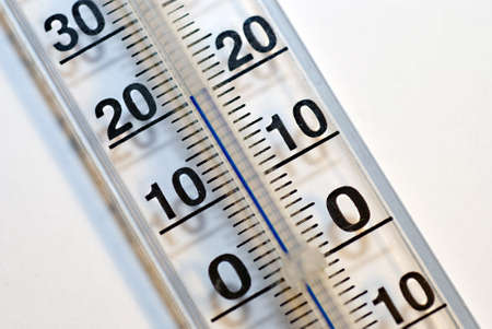 Classic thermometer with scale showing 20  photo