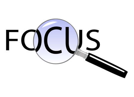 enlarged: Text FOCUS enlarged by a magnifying glass