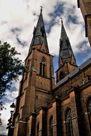neo gothic: Uppsala Cathedrals two towers against a blue sky Stock Photo