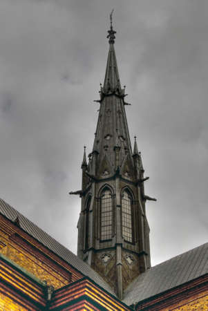 neo gothic: Dramatic picture of tower in Gothic style at Uppsala Cathedral Stock Photo