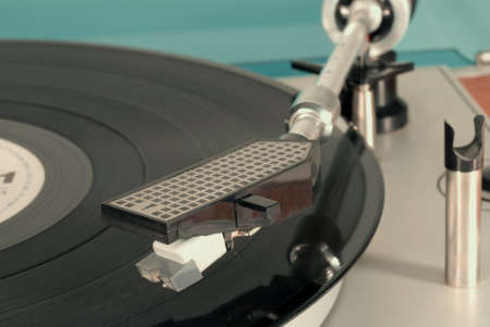Old record player in retro-style, close-up with shallow depth of field Stock Photo - 11854674