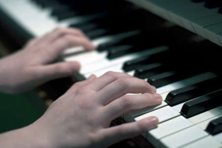 Close up of young girls hands, playing the keys Stock Photo - 13628820