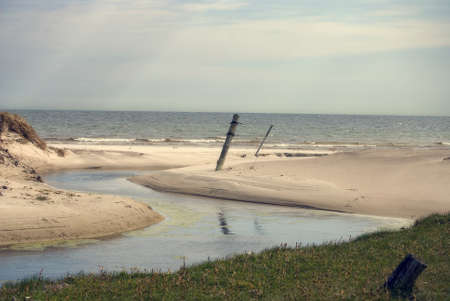 Small stream that flows into the sea at the beach Stock Photo - 13628381
