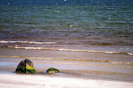 Sandy beach with rock and colorful water Stock Photo - 14473941