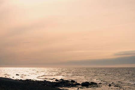 Dark stone beach, ocean and evening sky Stock Photo - 14473910