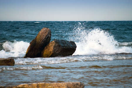 Big wave splash over rocky coast Stock Photo - 14473919