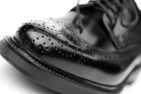 Close up of stylish black brogue shoe photo