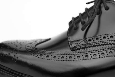 footgear: Close up of stylish black brogue shoe