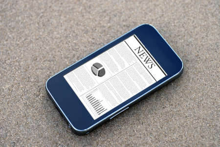 Close up of mobile phone on beach, with news application photo