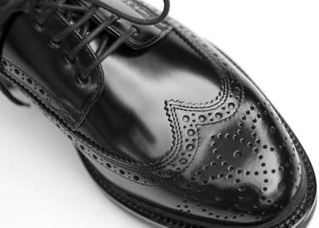Close up of stylish black brogue shoe