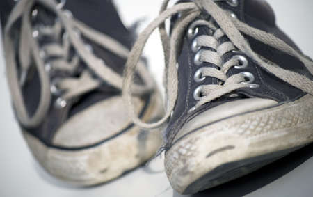 Old grungy sneaker on white background Stock Photo - 16418334