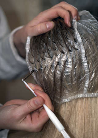 hair dye: Woman is being prepared for hair dyeing, close up with shallow depth of field