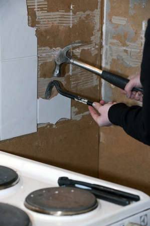 Tile being removed, young woman doing renovation in kitchen, iso 800 Stock Photo - 17766219