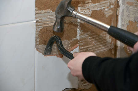 Tile being removed, young woman doing renovation in kitchen, iso 800