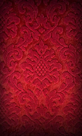 Old red brocade fabric pattern background photo