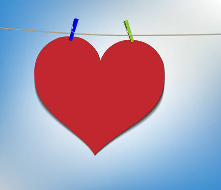Big red heart hanging on clothesline, laundry day