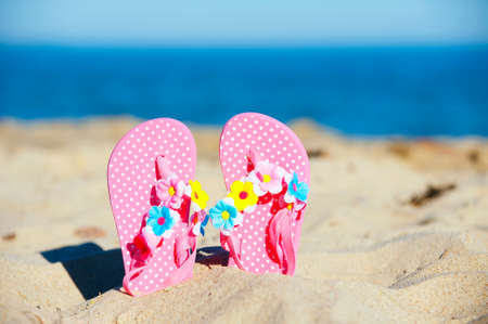 Cute flip-flop at the sandy beach photo