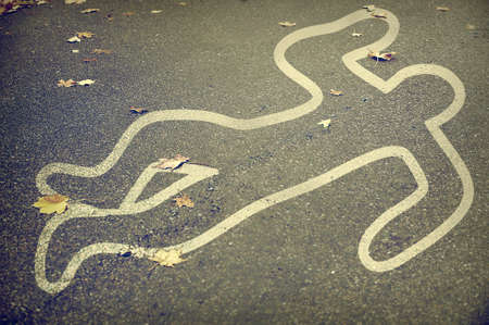 White chalk marking the body at the crime scene Stok Fotoğraf