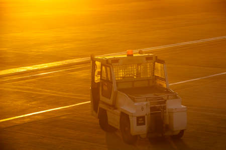 tow tractor: Airport towing truck in early morning sunlight
