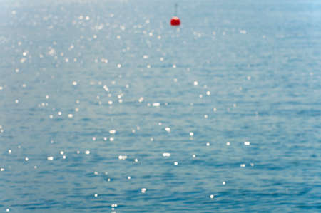 buoy: Blurred summer background with red buoy Stock Photo