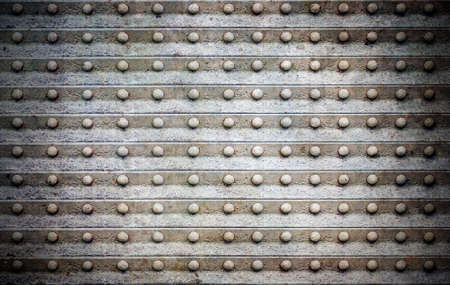 aluminium texture: Grunge background with bolts in row