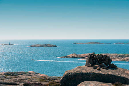 Blue sky and sea, sailboats in rocky archipelago on the west coast of sweden Stock Photo