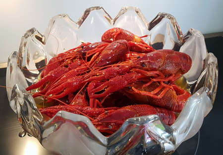 Closeup of red boiled crayfish in glass dish