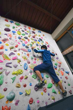 Rock wall climbing. Stock Photo