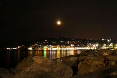Liguria, Italy, The lights of the night reflecting on the sea