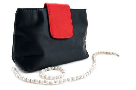 Female bag and beads isolated on a white background photo