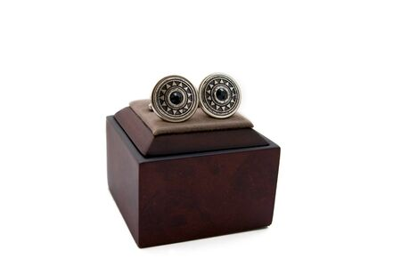 cuff links: Cuff links in a box on white background