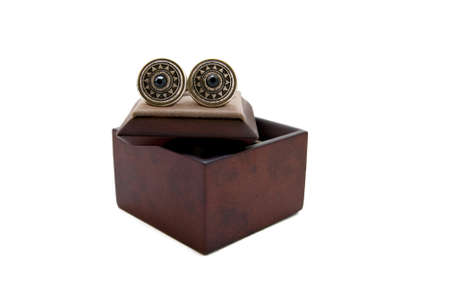 Cuff links in a box on white background Stock Photo - 8095454