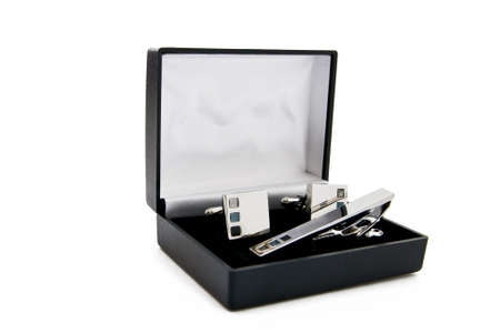 Cuff links in a box on white background Stock Photo - 8095459