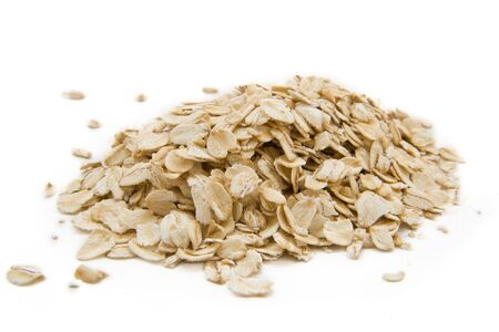 Oats flakes isolated on the white photo