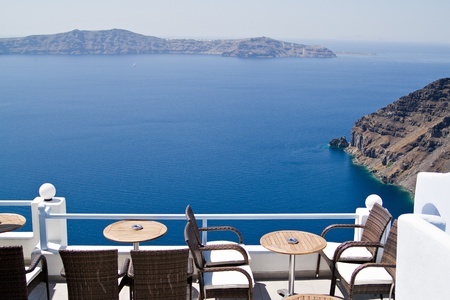 sunterrace with a view at the caldera, Santorini   Greece photo