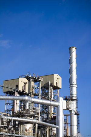 exhaust valve: Refinery against blue sky Stock Photo