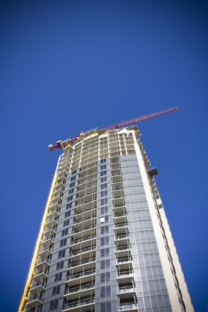 lattice window: Condo under construction with crane on top