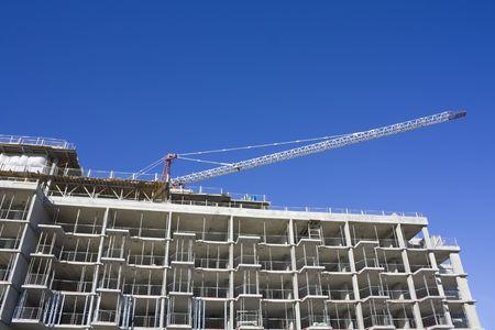 Condo under construction with crane on top