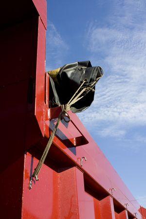 dump truck: Rolled up Tarp of Dump Truck