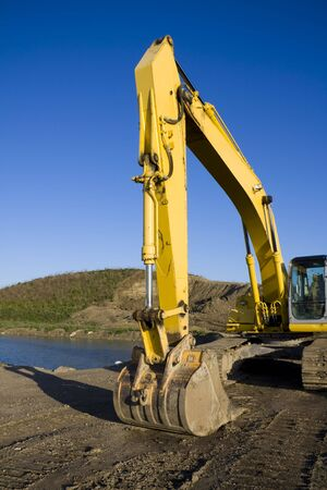 Excavator by Pond Stock Photo - 4874266