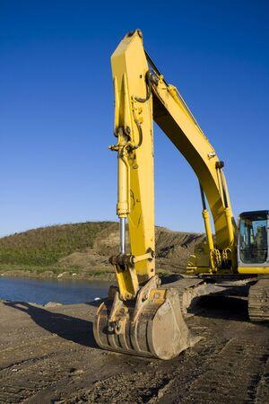 Excavator by Pond Stock Photo - 4874266