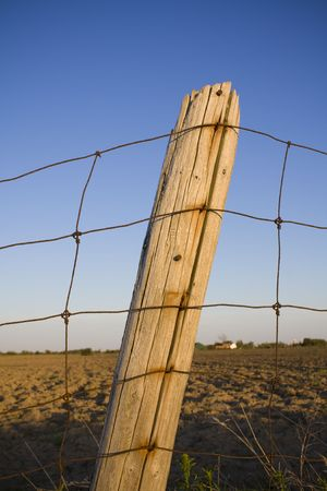 Fence post outside farmland