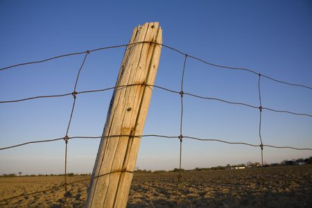 Fence post outside farmland Stock Photo - 4977297