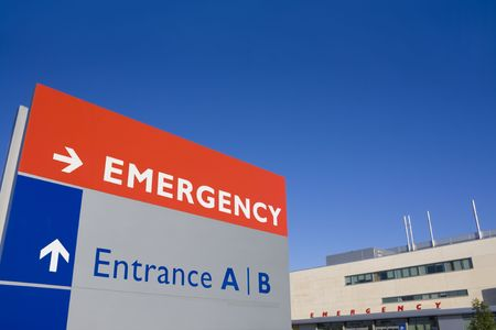 Modern hospital with emergency sign photo