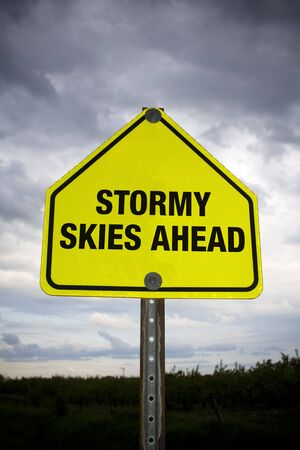 Stormy skies ahead road sign against stormy sky